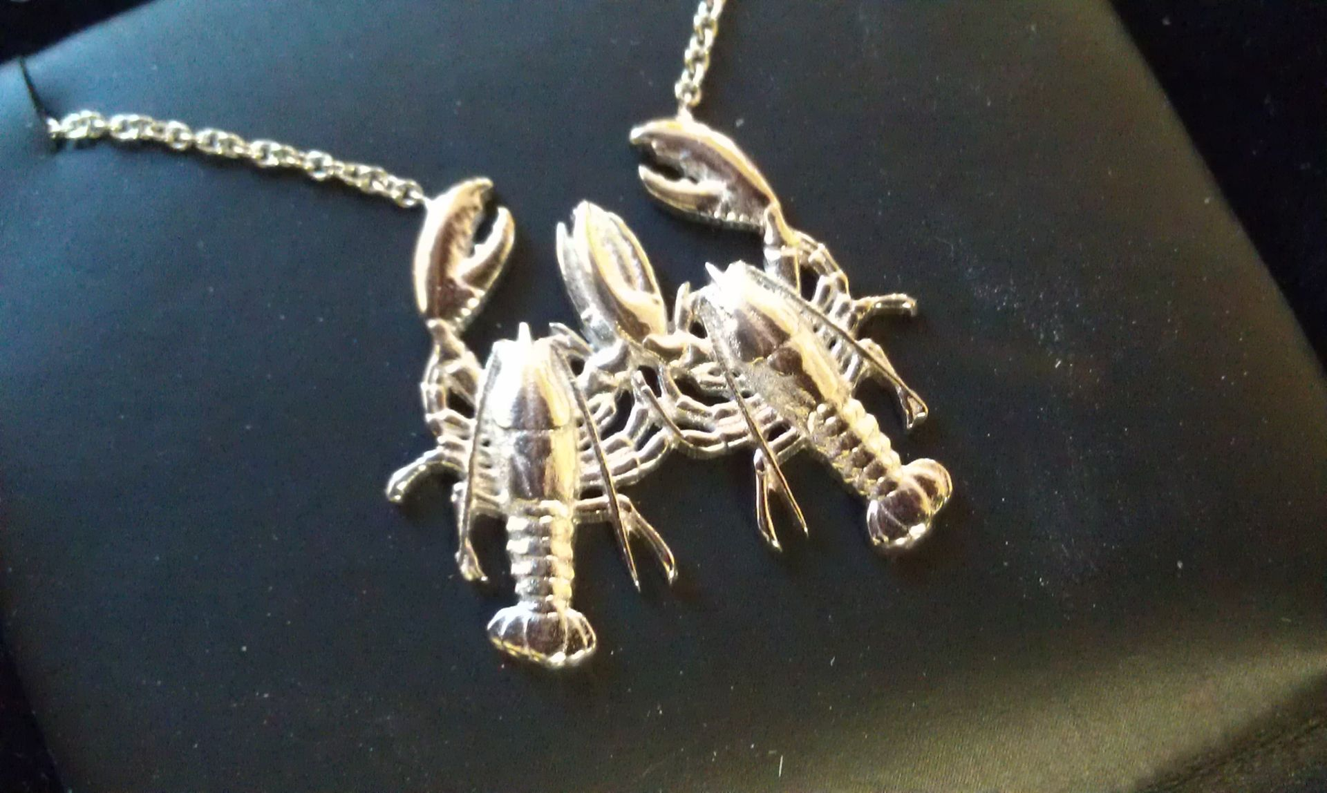 Buy a custom made platinum lobster necklace made to order for What is platinum jewelry made of