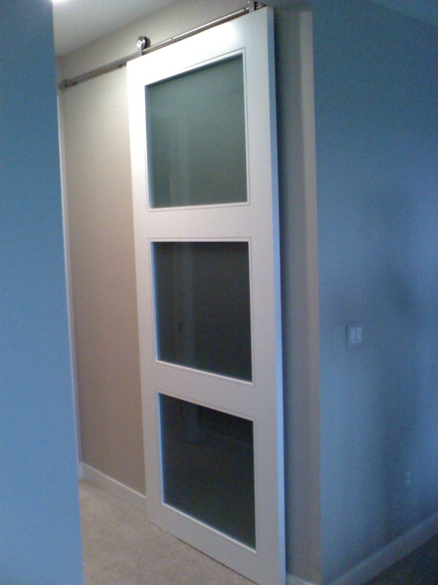 hand crafted custom closet doors with barn door hardware. Black Bedroom Furniture Sets. Home Design Ideas
