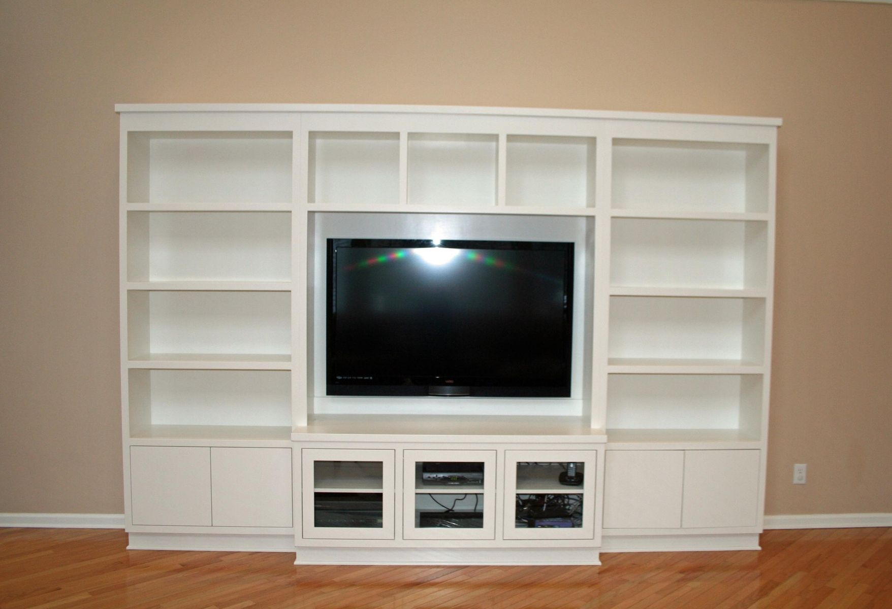 Custom made modern painted entertainment wall unit by two for Built in wall units