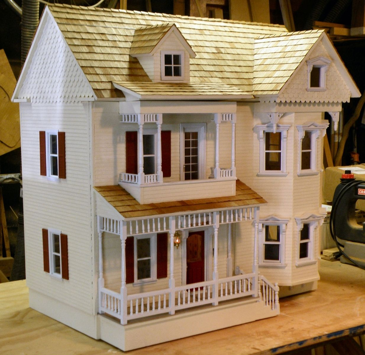 Hand crafted dollhouse restoration by rtw woodcraft Custom made houses