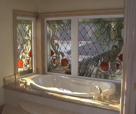 Custom Made Stained Glass With Hand Painted Kiln Fired Corner Window Treatment In The Master Bath