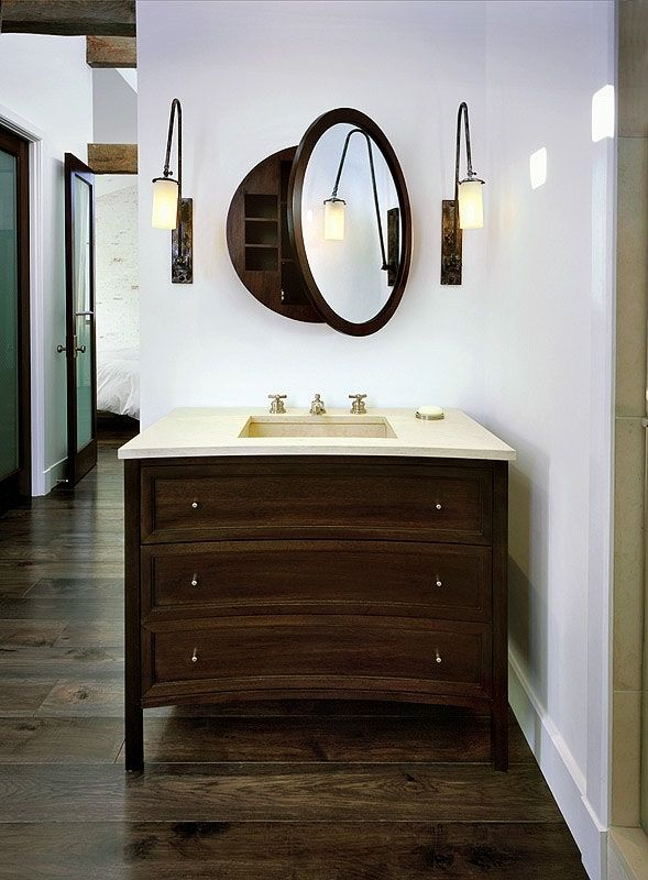 Handmade sconces at mirror in master bathroom by for Custom made bathroom mirrors