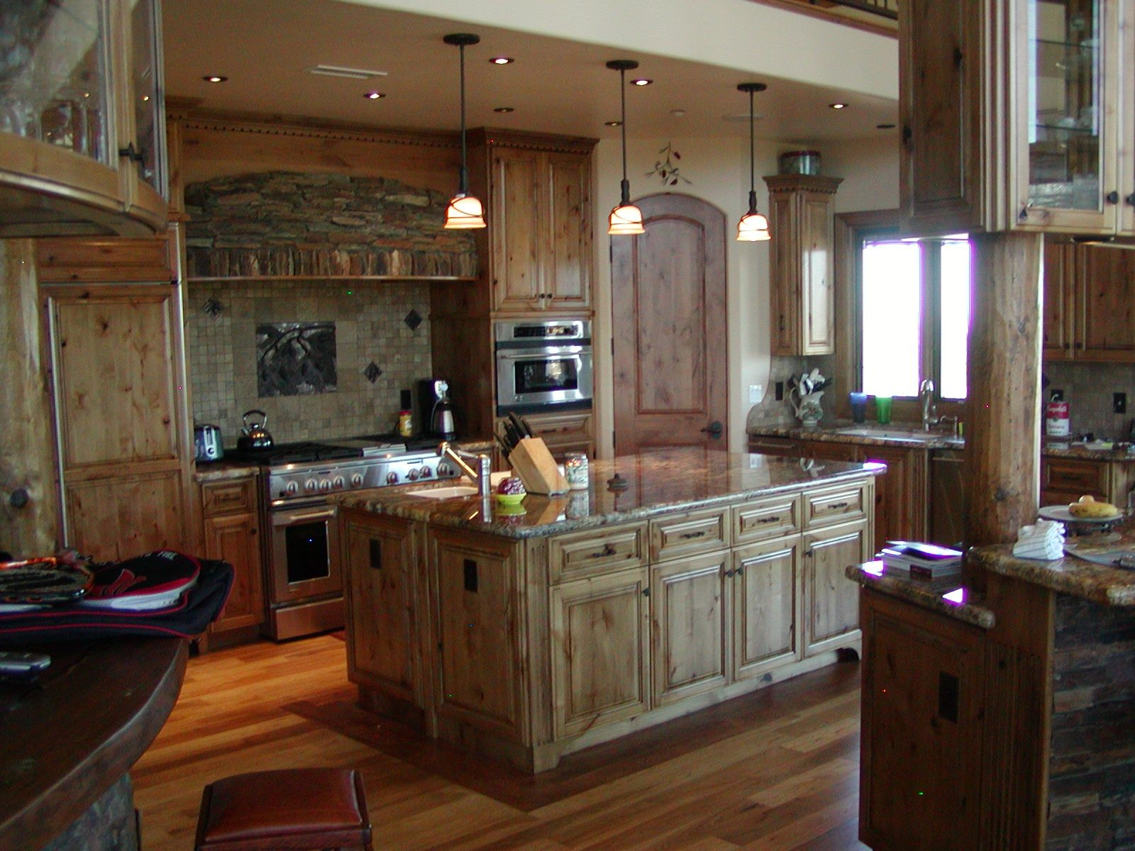 Hand crafted knotty alder custom made kitchen cabinets for Custom built kitchen cabinets