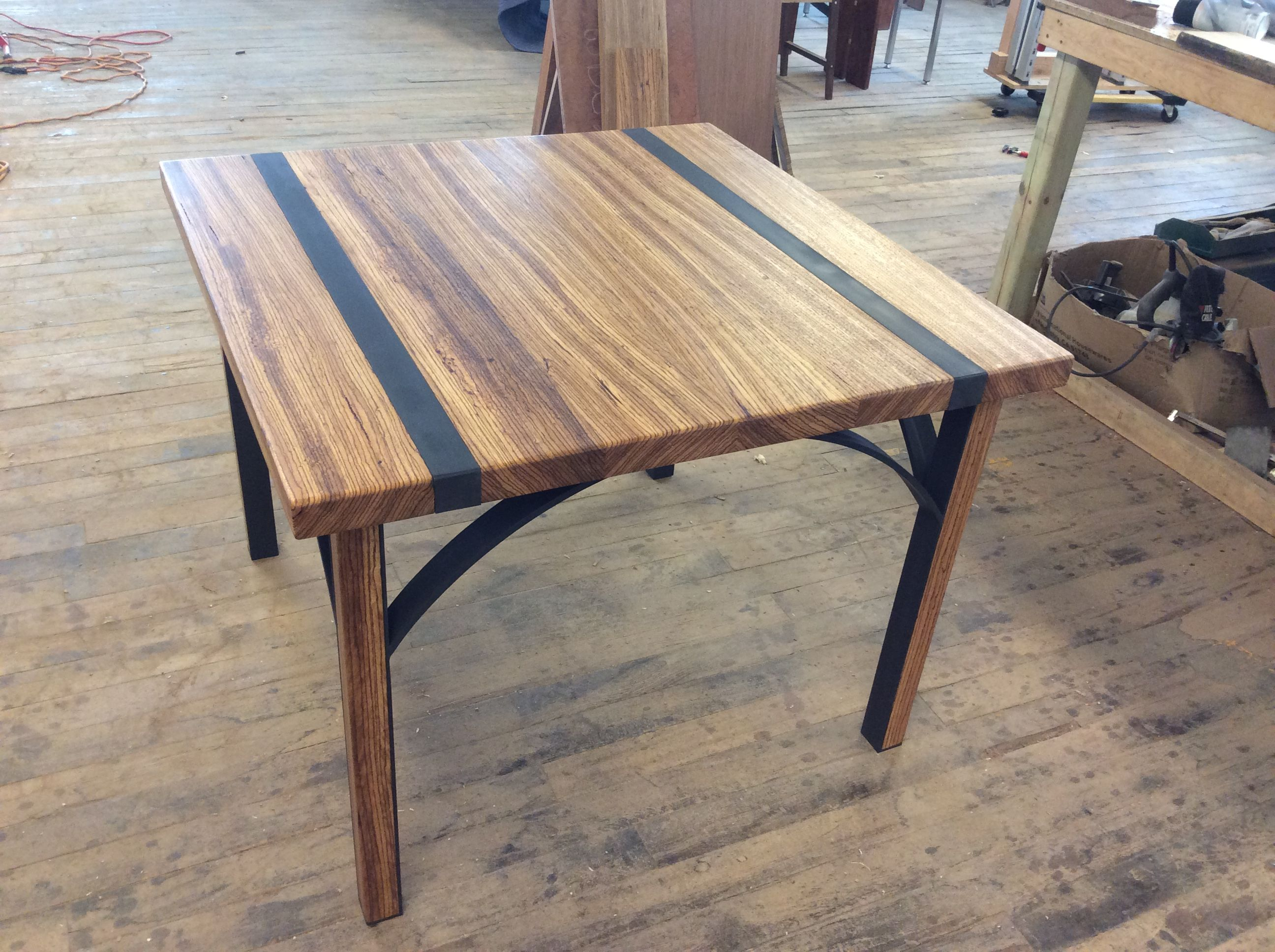 Hand made zebra wood dining table by donald mee designs