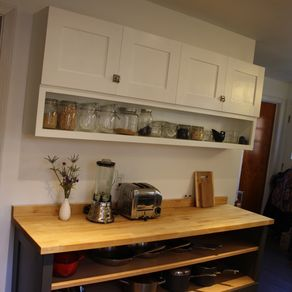Hand made bedroom wall unit by r e price cabinetry for Custom made kitchen cabinets cost