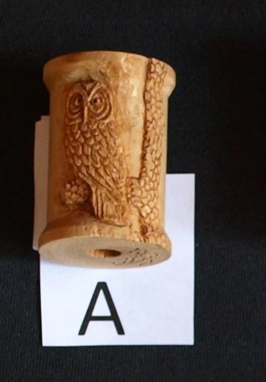 Custom minature relief carving of an owl on thread spool