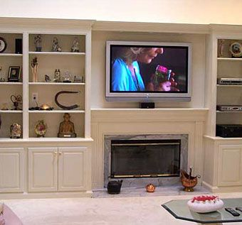 Custom Made Bookcases And Fireplace With Plasma Tv By
