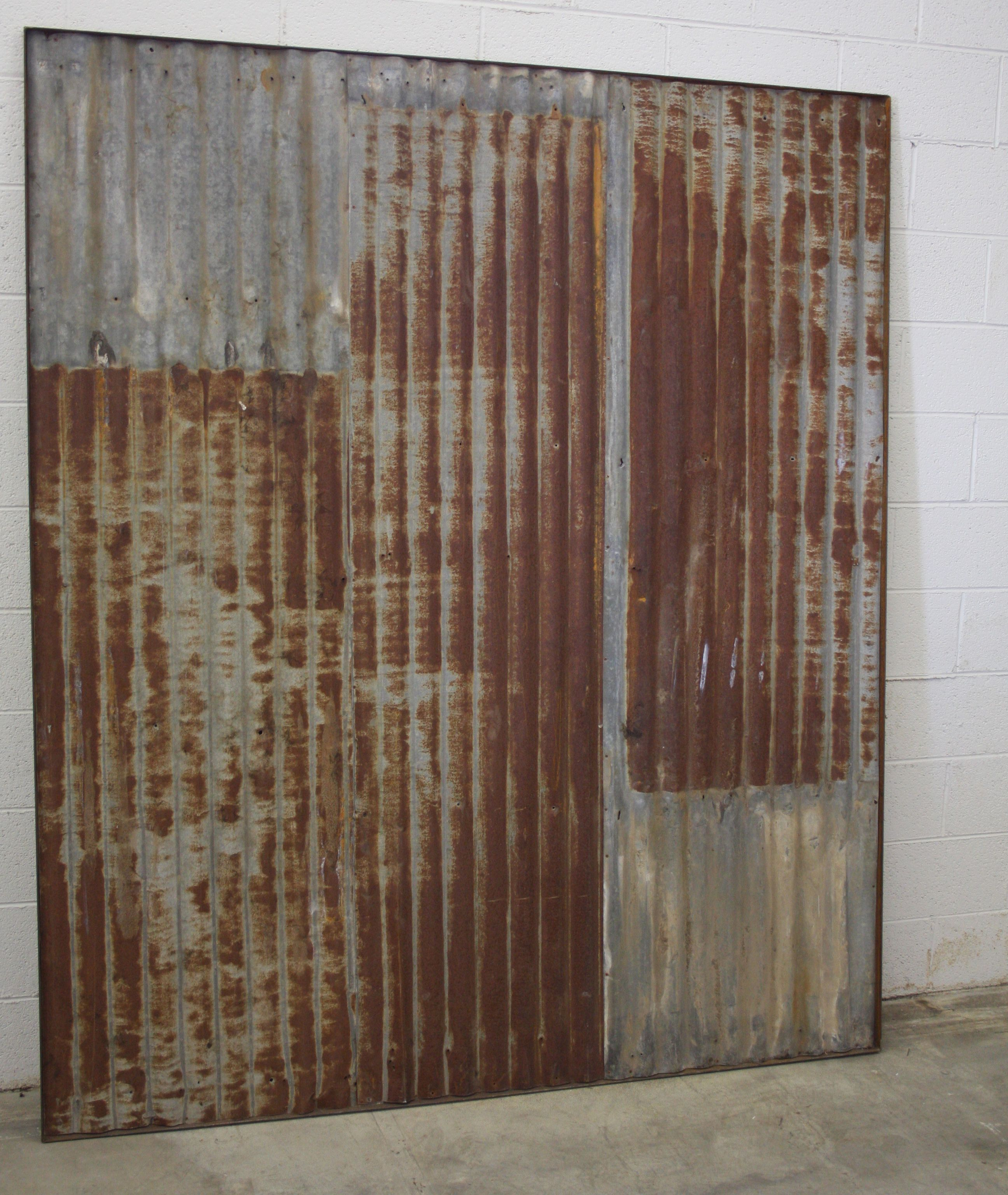 Custom rusty tin sliding barn doors by heirloom llc for Custom sliding doors