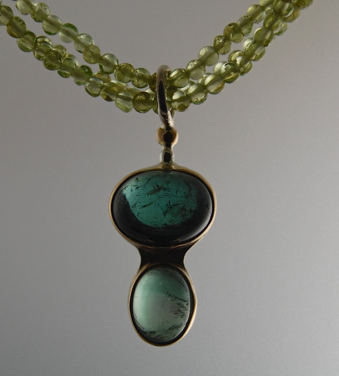handmade peridot necklace with a blue green tourmaline