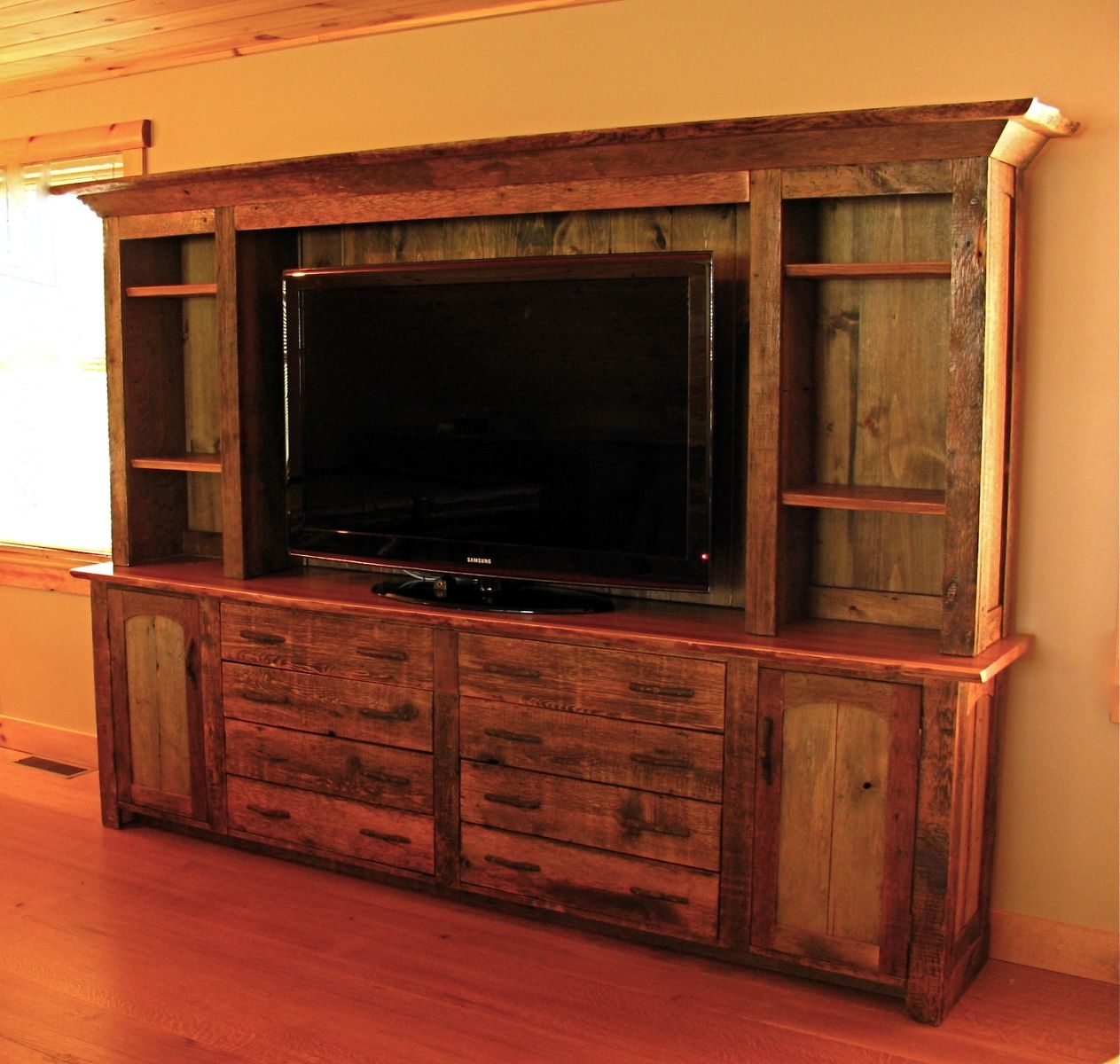 Hand made rustic entertainment center by custom rustic Furniture made from barn wood