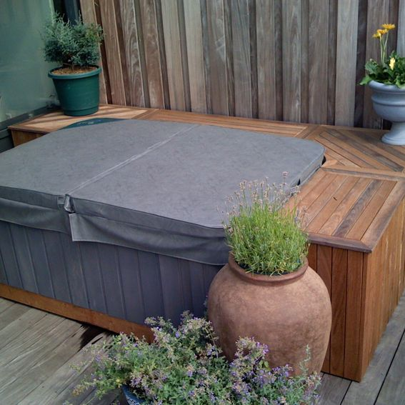 Hand made outdoor grill and hot tub storage by endless