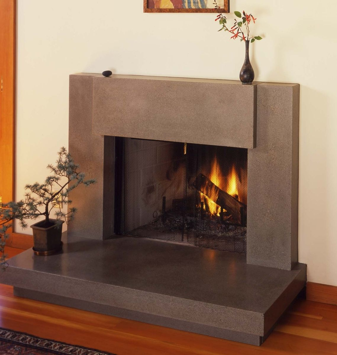 Custom contemporary polished concrete fireplace surround Decorative hearth