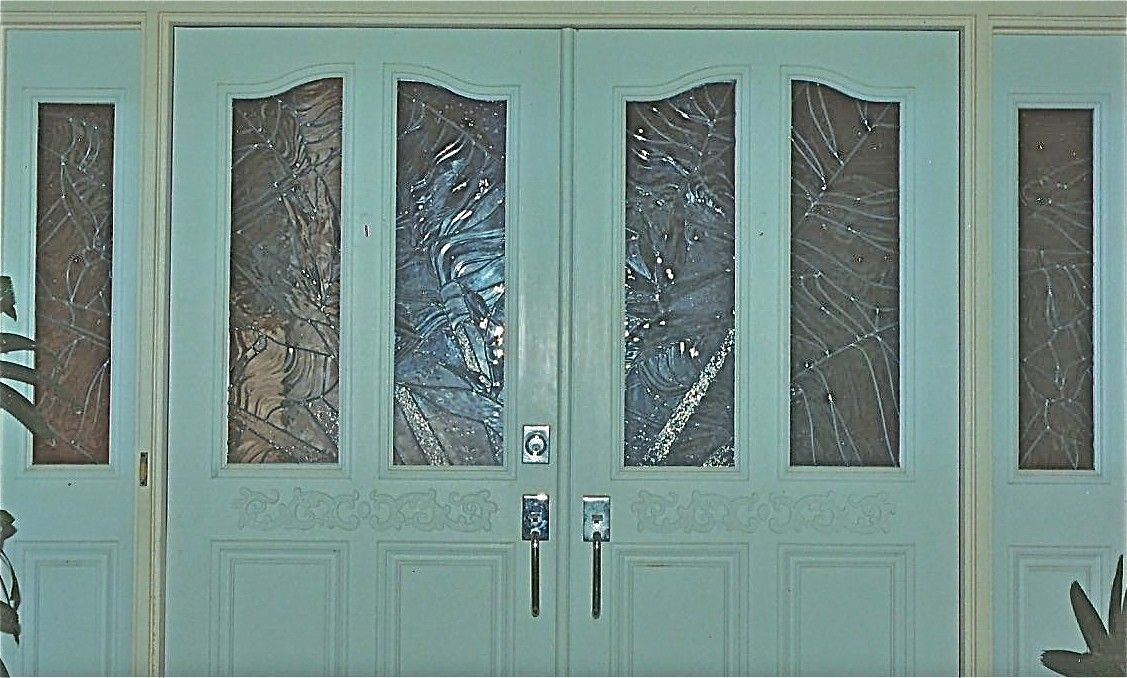 Hand made entryway doors and side light panels featuring for Textured glass panels