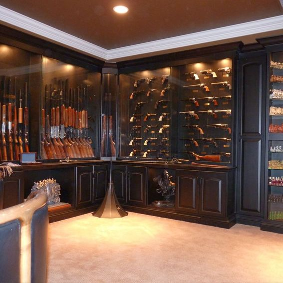 Hand crafted built in gun display cabinets by blue company inc - Custom display cabinets ...