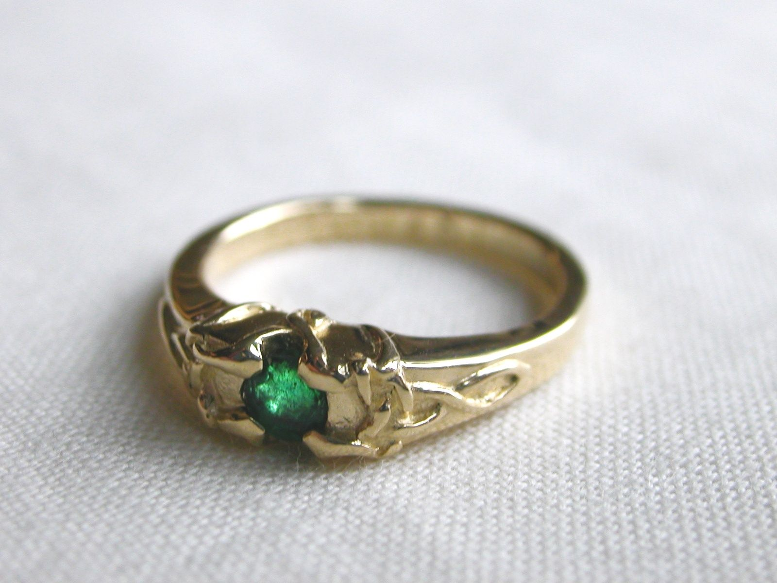 handmade celtic engagement ring with emerald by tossy