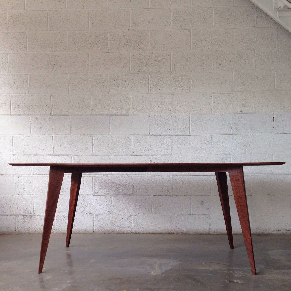 Hand crafted modern dining table in walnut by mtthrmn fine for Single leg dining table