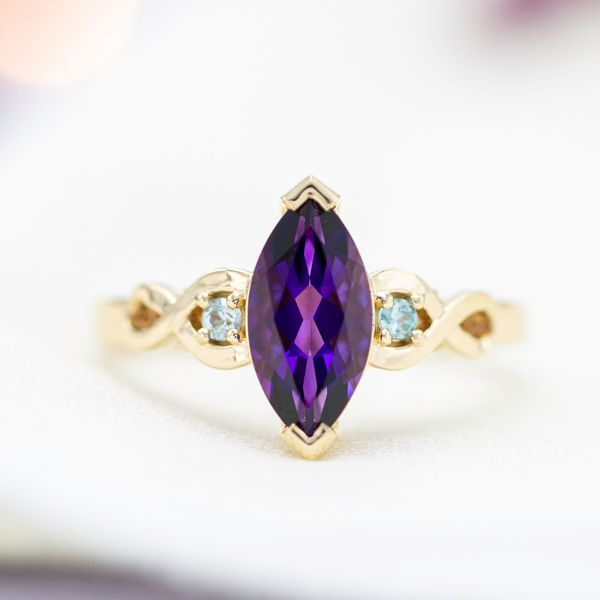 We used secure v-prongs to protect the more vulnerable points of the marquise cut amethyst in this engagement ring.