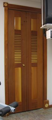 Custom Made Bi-Fold Redwood Louvered Door