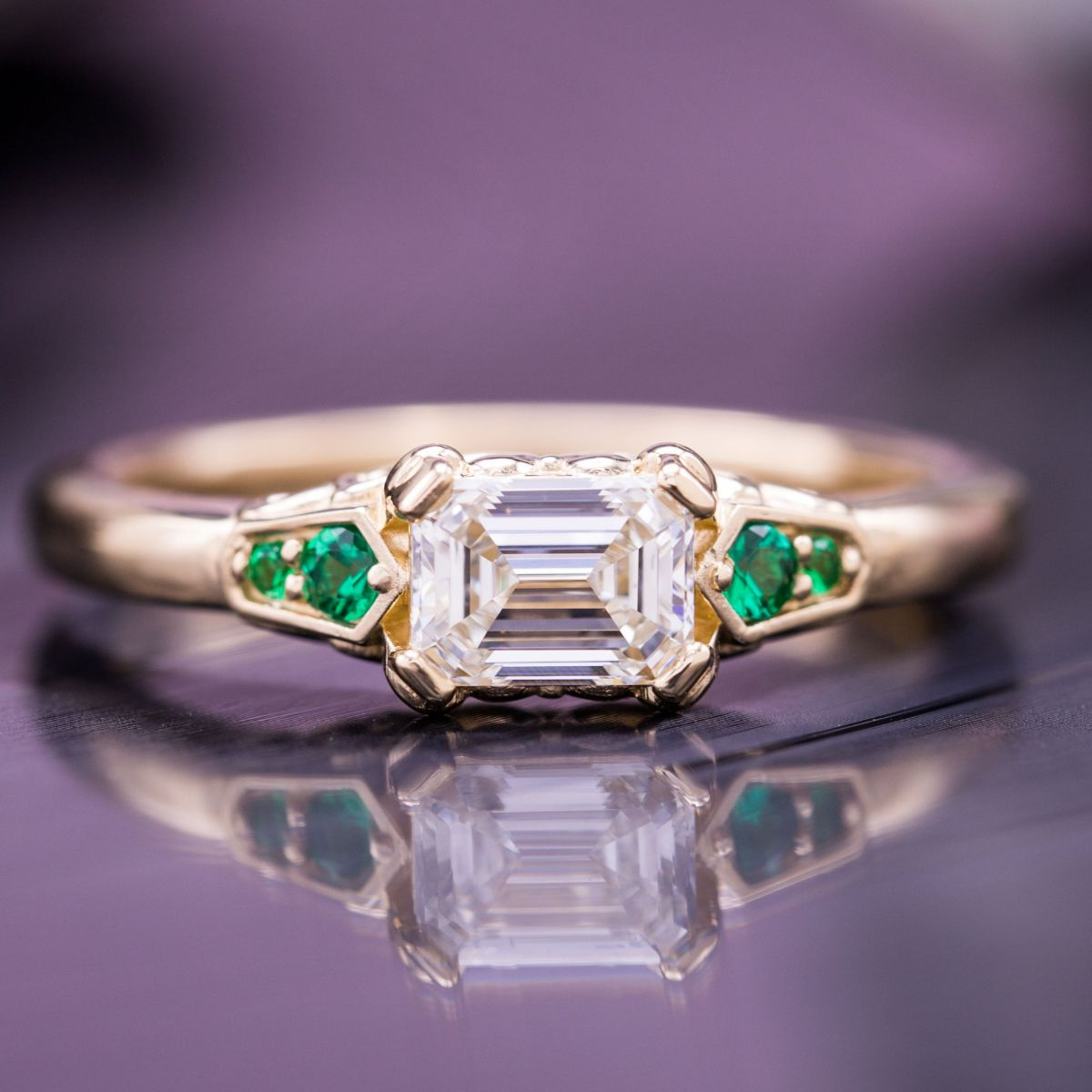 The Angular Step Cut Emerald Center Stone And Round Emeralds Set In Kite Shaped Shoulder Details Bring Geometry This Design: Art Deco Jewelry Wedding Rings At Websimilar.org