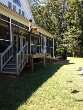 Custom Made Wooden Ramp And Screened In Deck