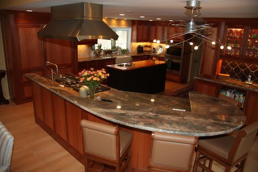 Custom Made Lyptus Kitchen With Two  Custom Islands And Ond Disterssed Black