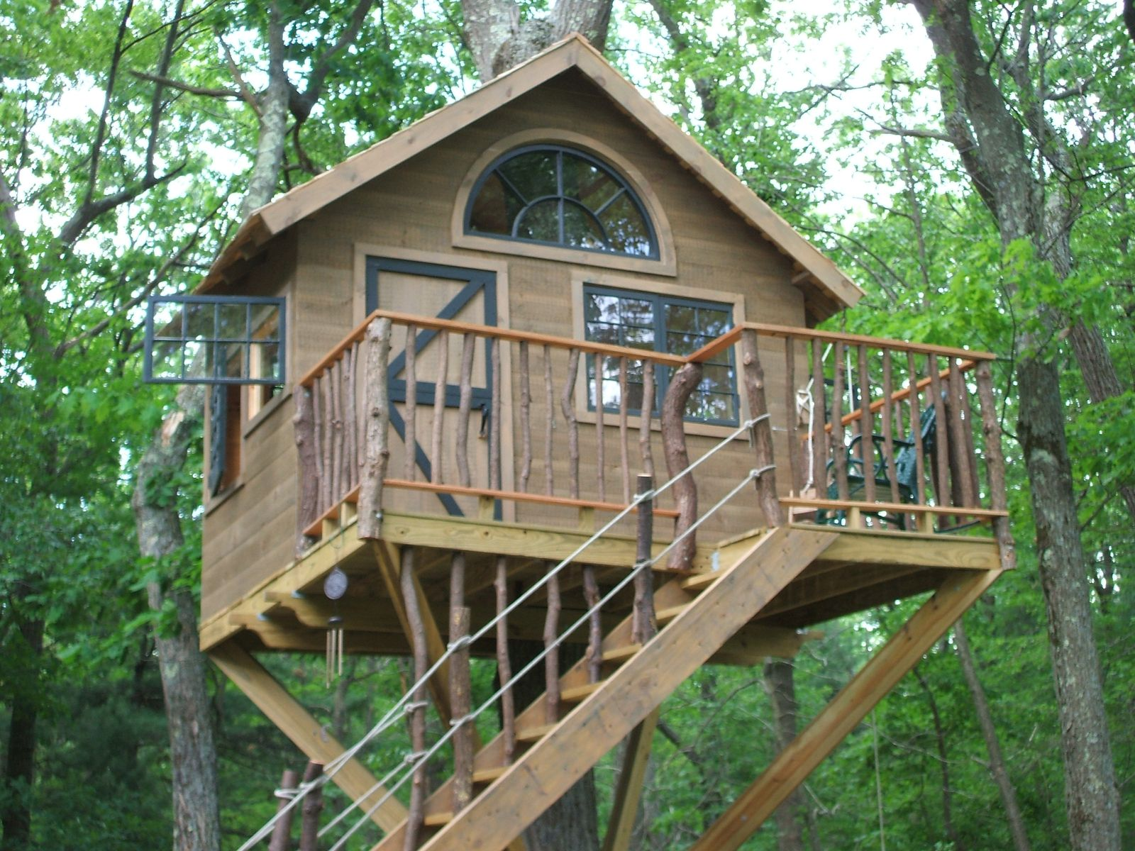 Handmade whimsical treehouse by wooden hammer llc for Simple easy to build house plans