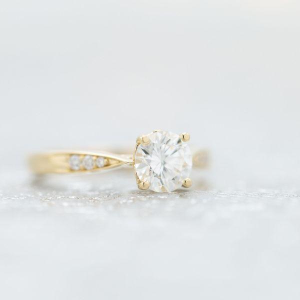 Round brilliant cut diamond with faint fluorescence.