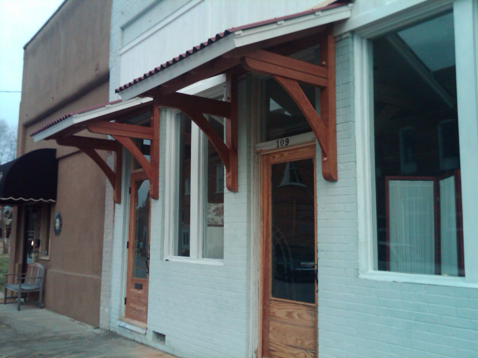 Handmade office door awnings by moresun custom woodworking for Exterior door awnings
