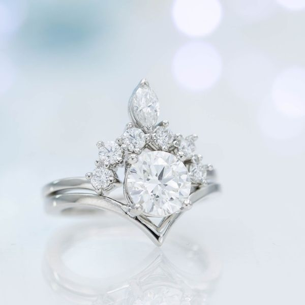 When paired, the curves of these rings balance perfectly to create a gorgeous bridal set.