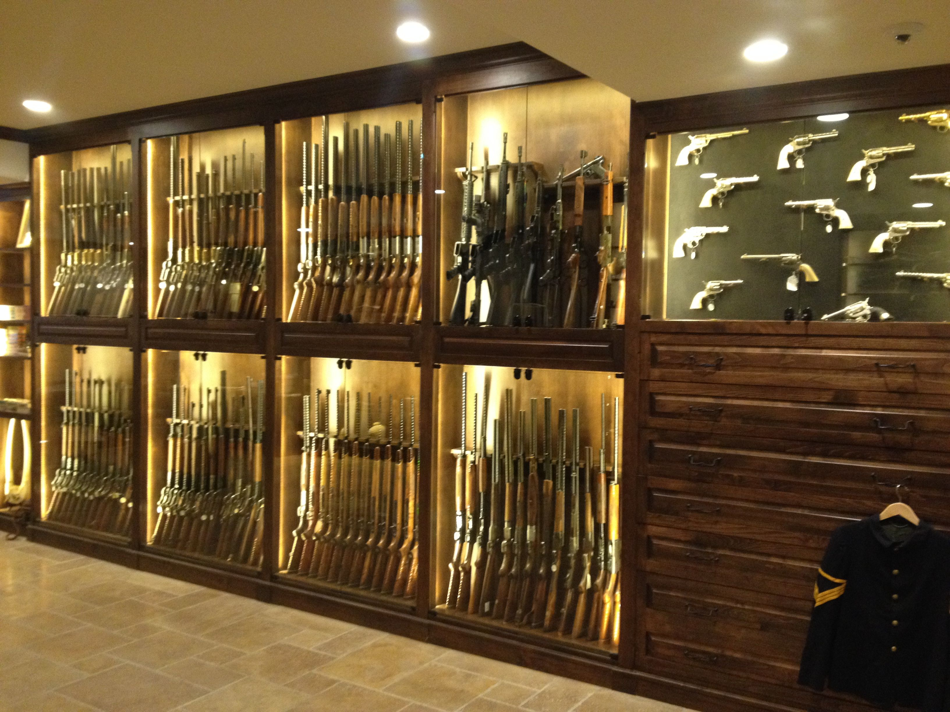 Hand crafted gun room cabinetry by enoch choi design for How to build a gun safe room
