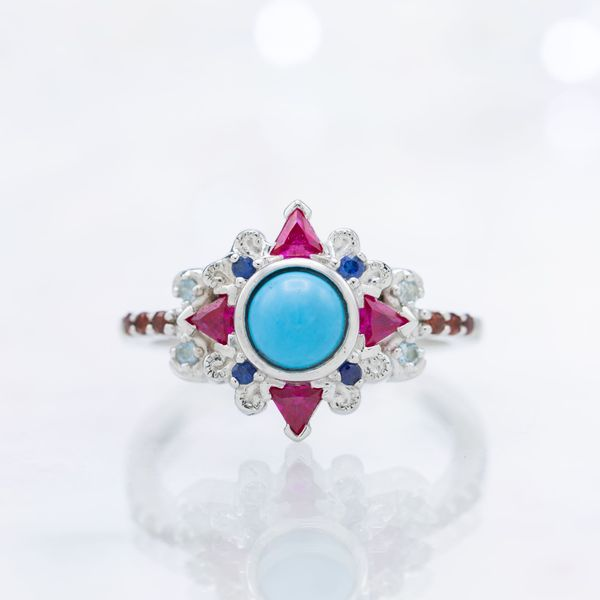 Vivid color play in this ring's blend of turquoise, ruby, sapphire, aquamarine, and garnet.