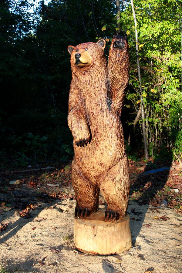 Hand made foot waving brown bear chainsaw wood sculpture