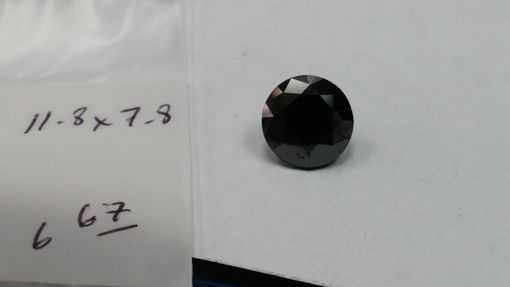 Custom Made 6.67 Cts Round Black Diamond
