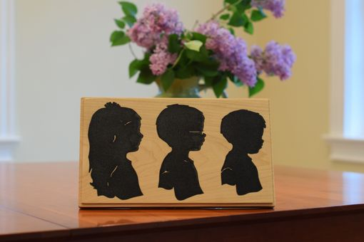 Custom Made Silhouettes Carved In Wood Filled With Epoxy