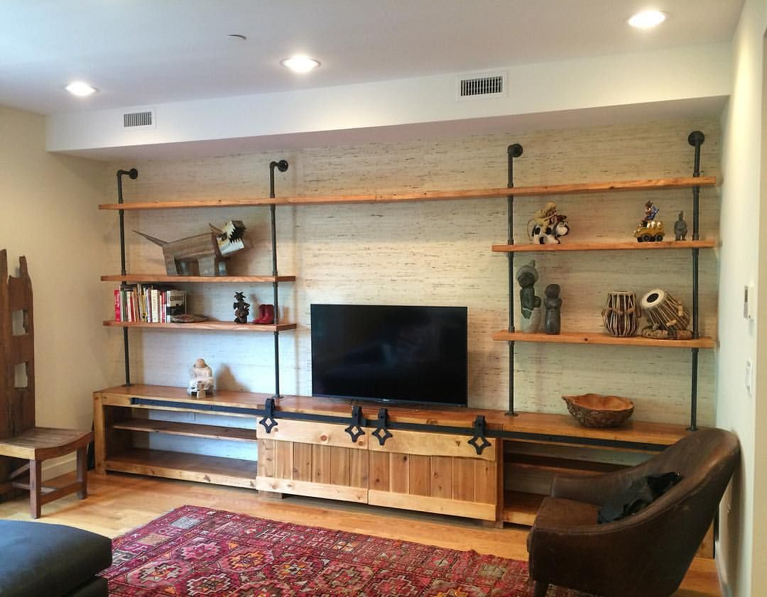 custom made industrial media console w barn doors by the