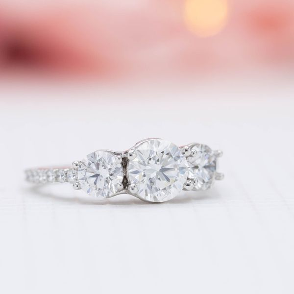 The lab-made diamonds in this three-stone setting have all the durability and beauty of a natural diamond.