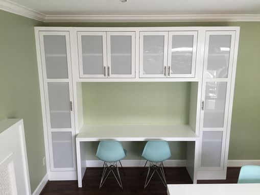 Custom Made Glass Paneled Built-In Cabinets With Integrated Desk/ Matching Fireplace Surround