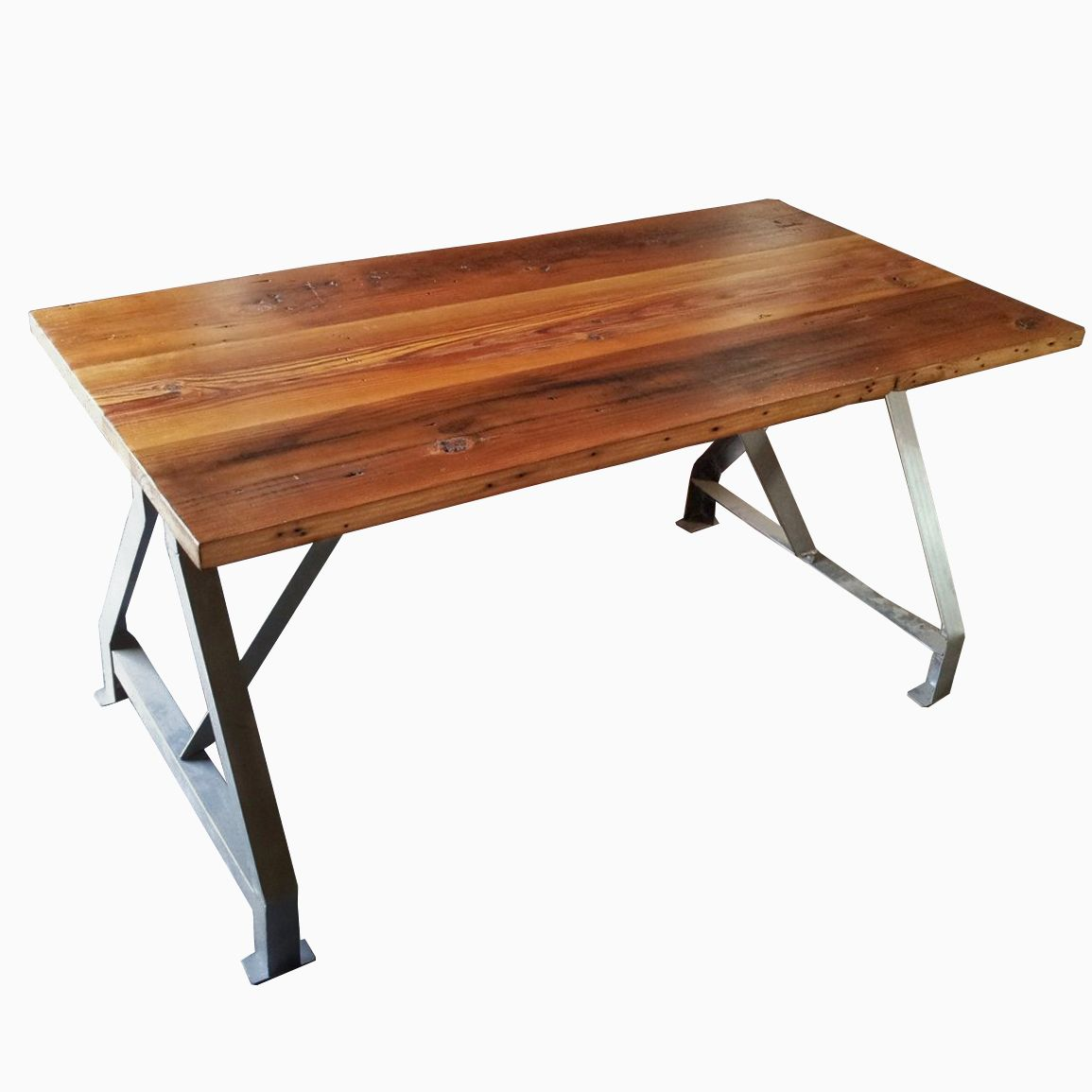 table with industrial metal base and made from reclaimed wood plank