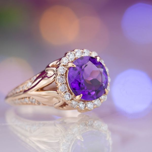 A scalloped halo gives this amethyst engagement ring a vintage feel.