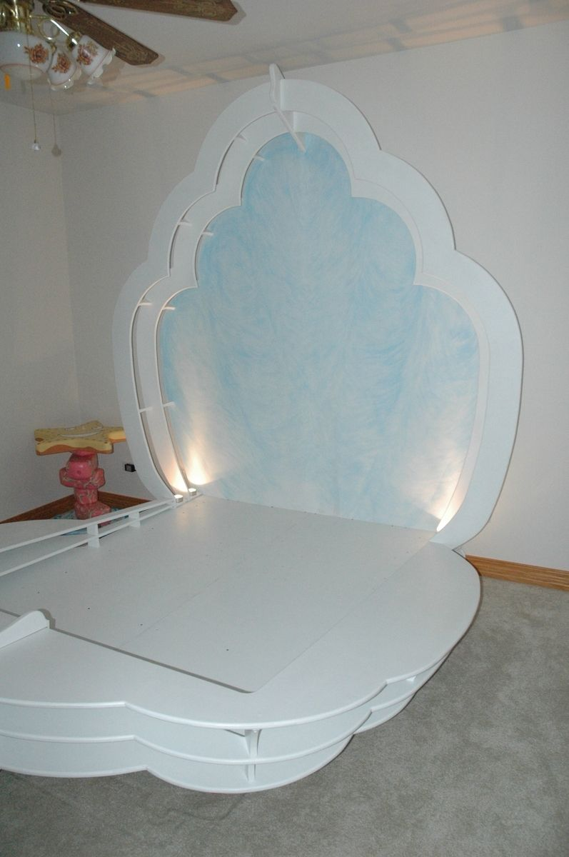 hand crafted ocean themed child's room with clam shell bed