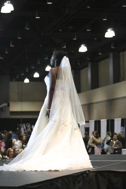 Custom Made Ivory Single Tier Veil With Irredesant Adornment.
