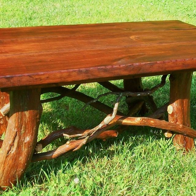 hand crafted rustic coffee table with mountain laurel base log