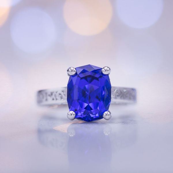An elongated cushion cut brings out the deep blue tones of this beautiful tanzanite.