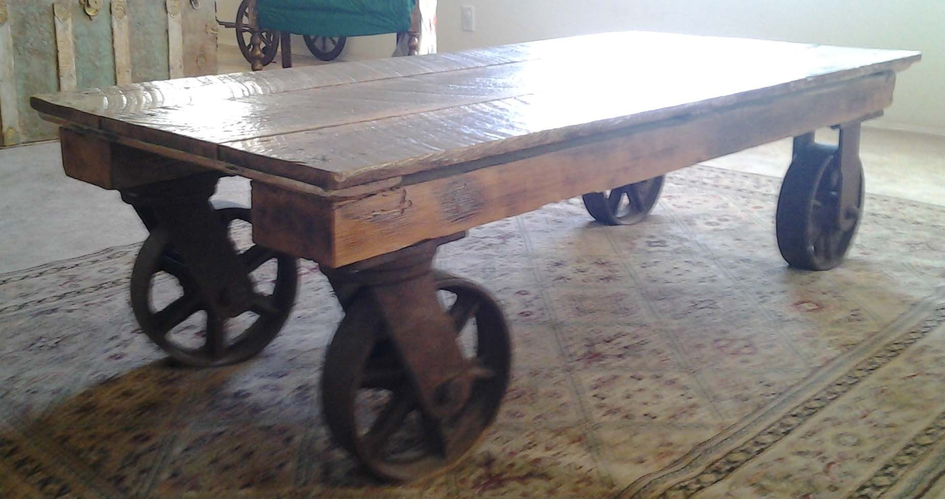 Hand made coffee table with iron industrial wheels by the for Coffee tables on wheels