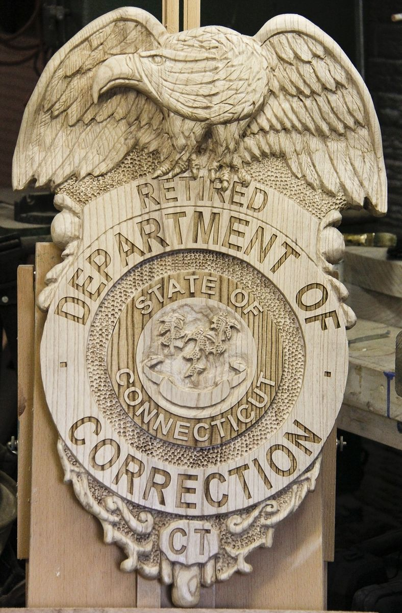 Hand crafted carved sign or relief by custom sculpture and