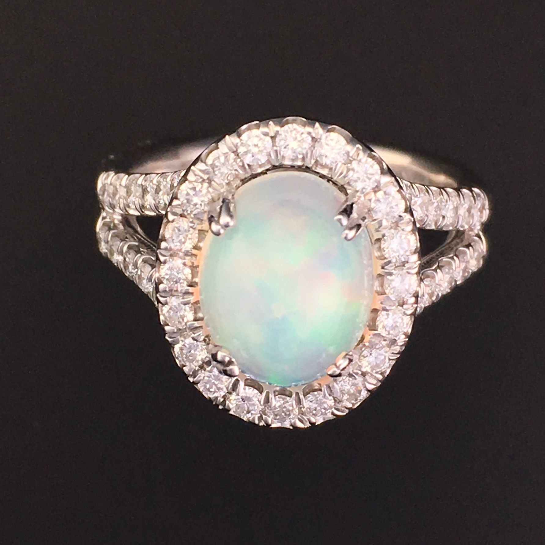buy a custom made oval opal halo engagement ring w