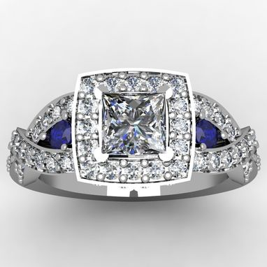 Custom Made Halo Ring With Sapphire Accents.