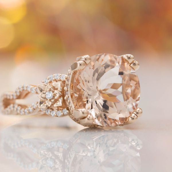 7 carats of peachy morganite that can't be missed surrounded by vintage-inspired rose accents.
