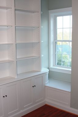 Custom Made Built In Radiused Bookcases With Window Seat Storage