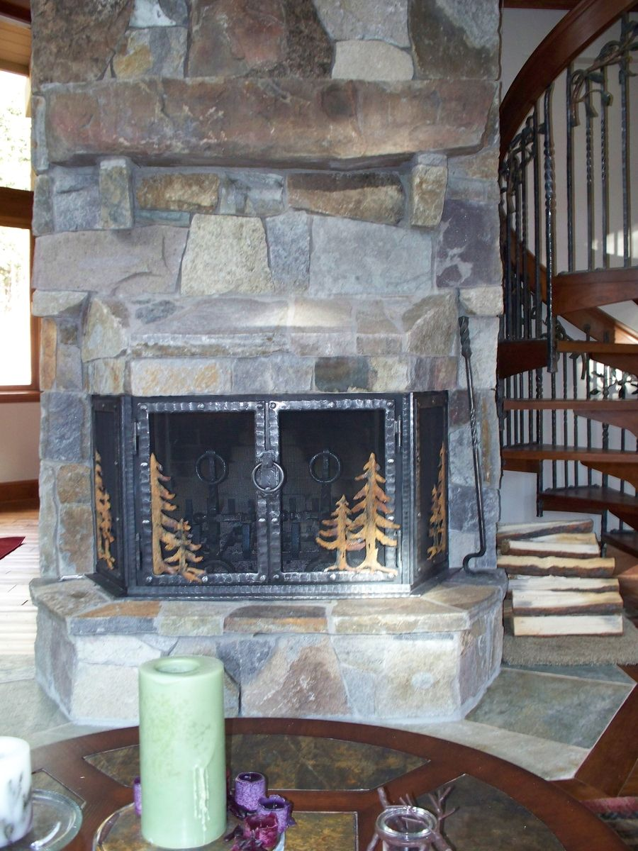 Hand Crafted Stone Fireplace Remodel With Hand Forged Iron Doors By